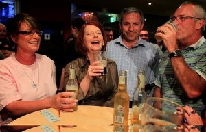 Julia Gillard pounds back a schooner of Old